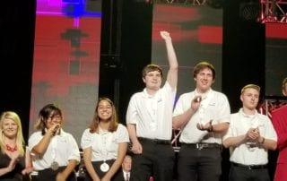 evan on stage - Vinal Tech IST Student Wins SkillsUSA Nationals